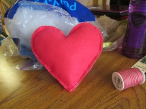 A blanket stitch heart is a very simple craft for someone who's learning to sew