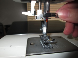 Inserting a sewing machine needle properly is important for any beginner learning to sew on a sewing machine - Sew Me Your Stuff