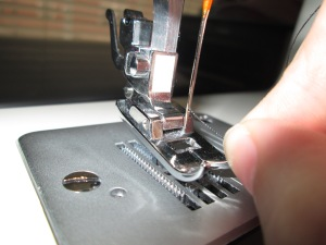 Threading your sewing machine needle properly is important for any beginner learning to sew on a sewing machine - Sew Me Your Stuff